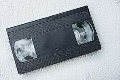 Old black videocassette on a gray background Royalty Free Stock Image