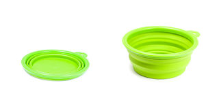 Plastic road bowl for pets (cat or dog) green color. Stock Photos