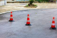 Three road cones overlapping the entrance. Plastic road cones restricting entry royalty free stock images