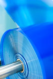 Plastic roll close-up. Packaging machine blue plastic roll close-up Royalty Free Stock Photo