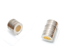 Plastic roll holding two dollar coins Royalty Free Stock Photography