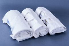 Plastic rolled up bags Stock Photos