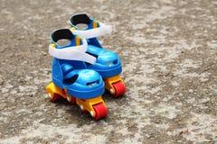 Plastic roller skates Royalty Free Stock Image