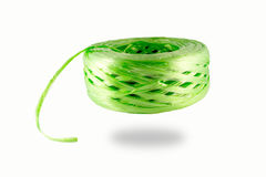 Plastic rope. Roll of green plastic rope on white background royalty free stock photo