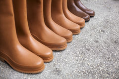 Plastic rubber boots. For sale on an open market under sunlight Royalty Free Stock Photography