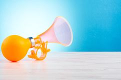 Plastic and rubber material bike horn for warning or announce object. Over beautiful reverberation gradient background royalty free stock images