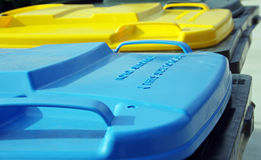 Plastic rubbish bins. Three colored plastic rubbish bins Royalty Free Stock Photography