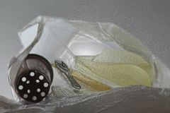 Plastic rubbish in clear plastic bag forming a wave shape royalty free stock photography