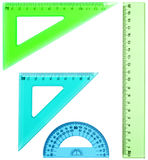 Plastic ruler, protractor, triangle, isolated on white background royalty free stock photo