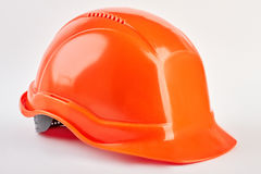 Plastic safety helmet isolated. Orange protective hat, white background. Industrial protection Stock Photography