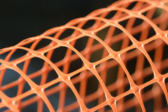 Plastic safety net for construction site. Construction mesh. Background stock photography