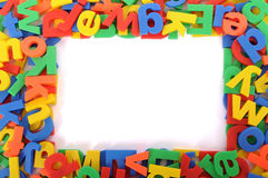 Plastic school toy, ABC letters of alphabet, background border frame, copy space Stock Photos