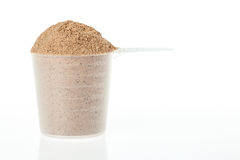 Plastic scoop of chocolate whey isolate protein Stock Photography