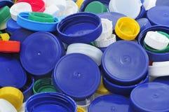Plastic screw caps. Closeup of a pile of plastic screw caps of different colors and sizes Stock Photos