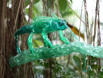 Plastic sculptures Pet Art. Sculptures of a chameleon made of plastic bottles made by Veronika Richterova. Sculptures are installed as a part of plants Royalty Free Stock Image