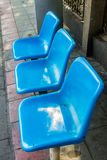 Plastic Seat, Blue chair at bus stop Royalty Free Stock Images
