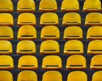Plastic seats - yellow Stock Image