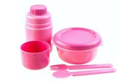 Plastic Set. Pink set of spoon,fork,bowl,bottle on white background Stock Photo