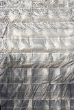 Plastic sheeting on scaffolding. Weatherproof plastic sheeting covering scaffolding to protect the workers Stock Images