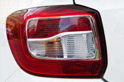 Plastic shiny modern tail light. Detail of a plastic shiny  modern tail light Royalty Free Stock Photography