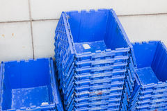 Plastic shipping boxes for delivery logistics, Blue plastic crate Royalty Free Stock Images