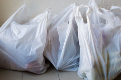Plastic shopping bags. Full frame view of full plastic shopping bags on tiled floor royalty free stock photo