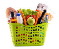 Plastic shopping basket with assorted gorcery products Royalty Free Stock Photography