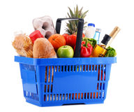 Plastic shopping basket with assorted gorcery products Stock Photos