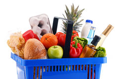 Plastic shopping basket with assorted grocery products Royalty Free Stock Photo
