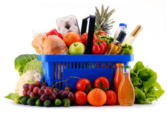 Plastic shopping basket with assorted grocery products Royalty Free Stock Images