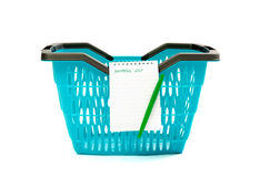Plastic shopping basket with blank shopping list. Royalty Free Stock Photography