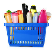 Plastic shopping basket with body care and beauty products Stock Photos
