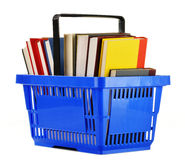 Plastic shopping basket with books on white Stock Photos