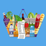 Plastic shopping basket full of groceries products. Metal shopping basket full of groceries products and receipt. Grocery store. Supermarket. Fresh organic food Stock Photo