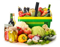 Plastic shopping basket and grocery on white Stock Images