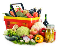 Plastic shopping basket and grocery on white Royalty Free Stock Photography