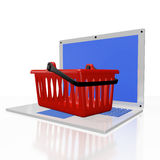 Plastic Shopping Basket on Laptop Royalty Free Stock Image