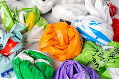 Plastic shopping carrier bags. Rolled up for storage Royalty Free Stock Images