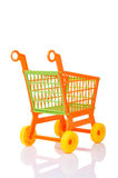 Plastic shopping cart against Royalty Free Stock Photo