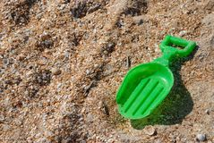 Plastic shovel on sand Stock Image