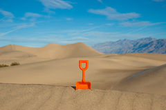 Plastic Shovel in a Sand Dune Royalty Free Stock Image
