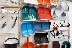 Plastic shovels and other household goods in store. Plastic shovels and other household goods in the store Stock Photos