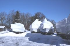 Boats with Snow and Shrink Wrap. Plastic shrink wrap on boats, to protect boats and interior of boats from the winter elements Stock Photography