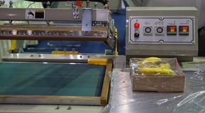 Free Plastic Shrink Wrapping Machine Royalty Free Stock Image - 140976596