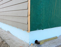 Plastic Siding Wall Construction and Insulation Membrane on House Exterior Wall. Royalty Free Stock Image