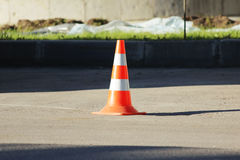 plastic signaling traffic cone encloses a place in the parking lot for trucks Stock Photo