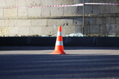 plastic signaling traffic cone encloses a place in the parking lot for trucks Stock Image