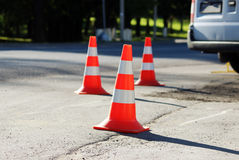 plastic signaling traffic cone encloses a place in the parking lot for trucks Stock Photos