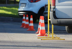 plastic signaling traffic cone encloses a place in the parking lot for trucks Royalty Free Stock Photo