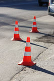 plastic signaling traffic cone encloses a place in the parking lot for trucks Royalty Free Stock Photos